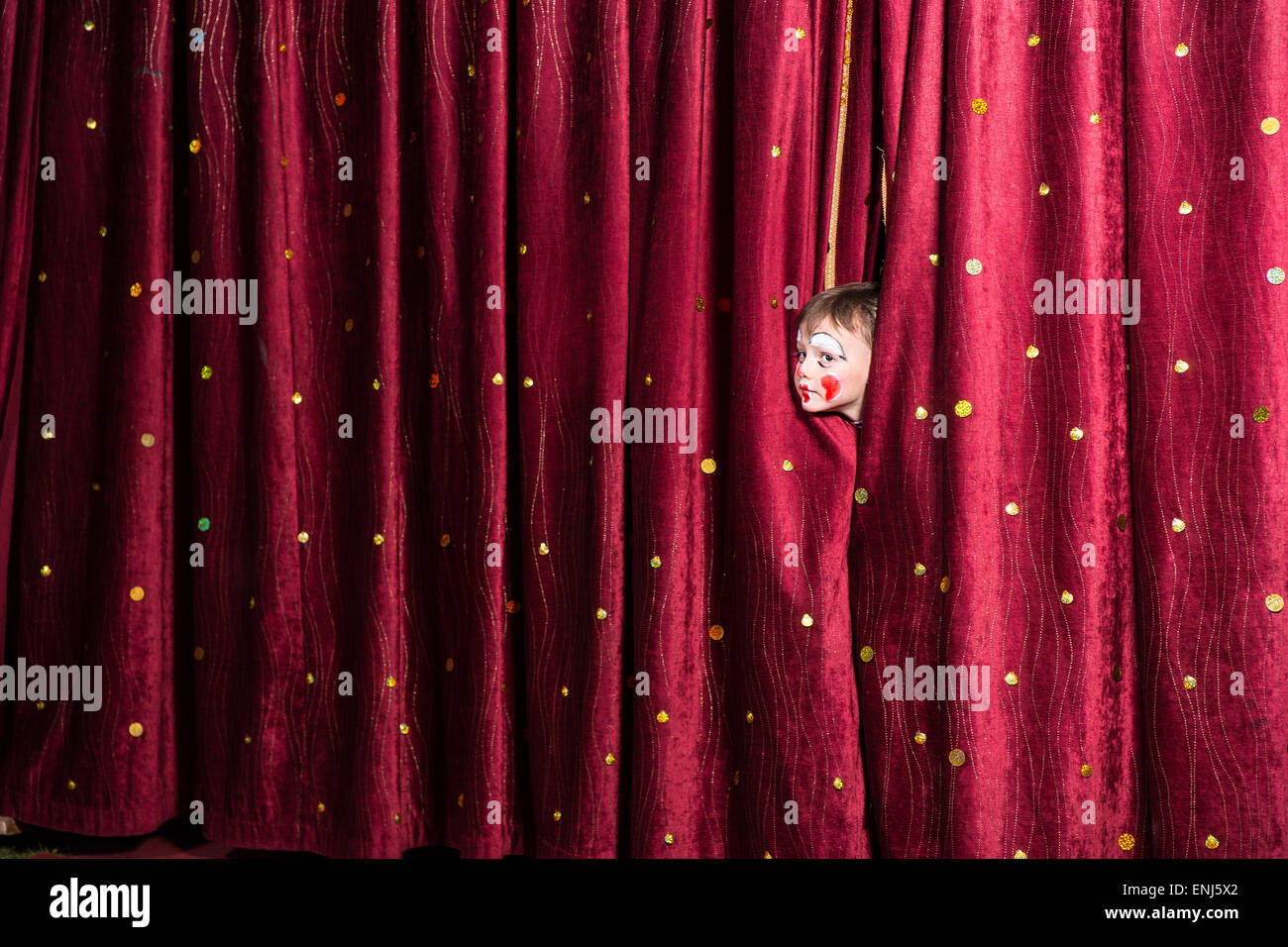 Closed theater curtains - Impatient Little Boy On Stage Poking His Head Out From Between The Closed Curtains As He