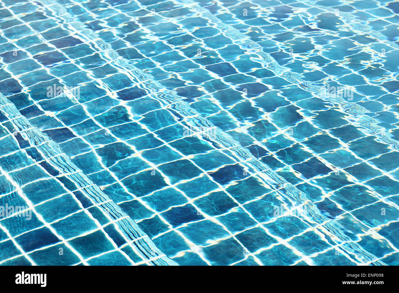Blue ceramic wall tiles and details of surface on swimming pool ...