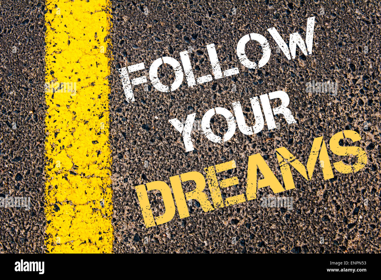 FOLLOW YOUR DREAMS Motivational Quote. Yellow Paint Line On The Road  Against Asphalt Background. Concept Image