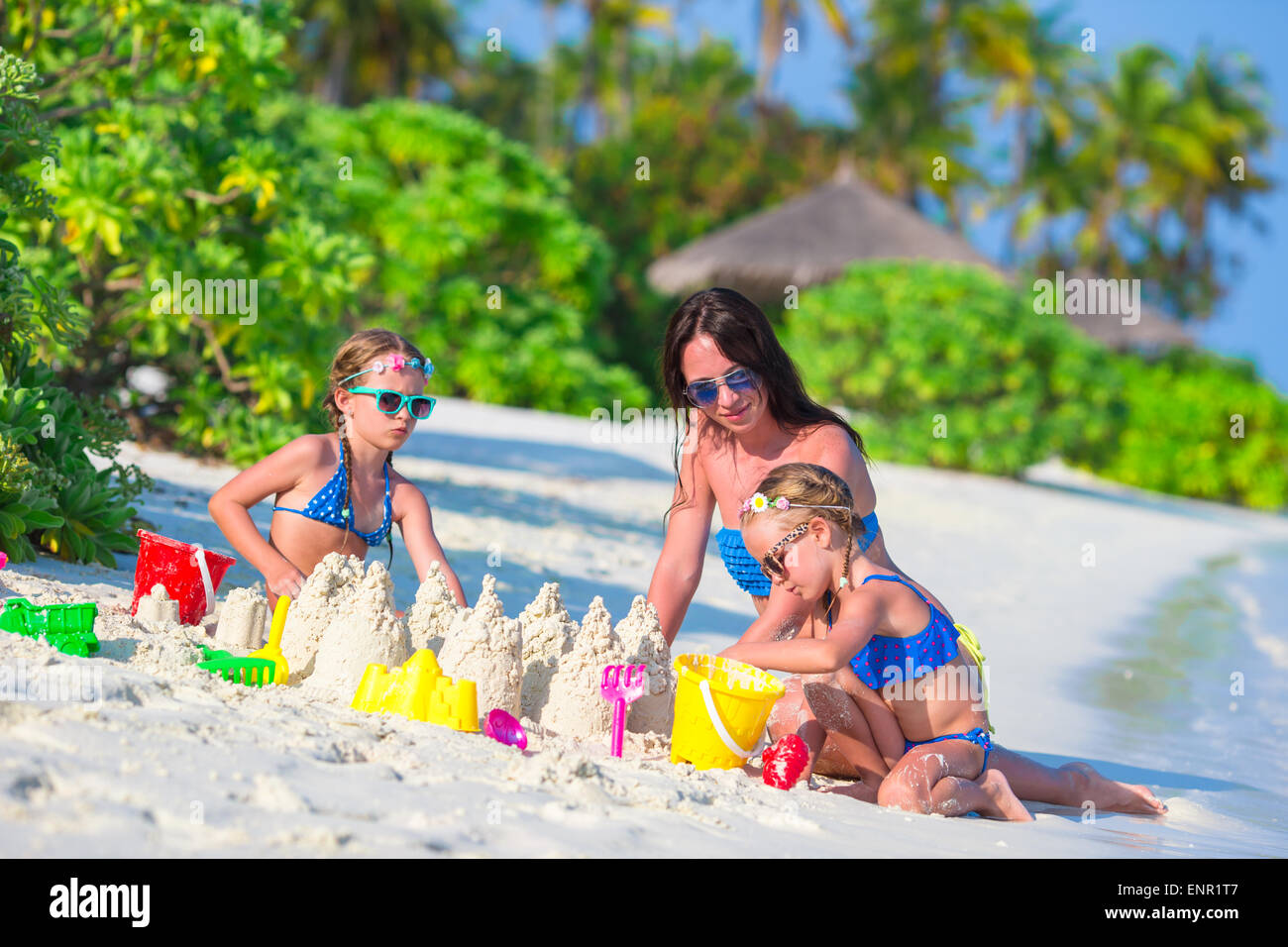 Beach Toys For Girls : Little girls and happy mother playing with beach toys on