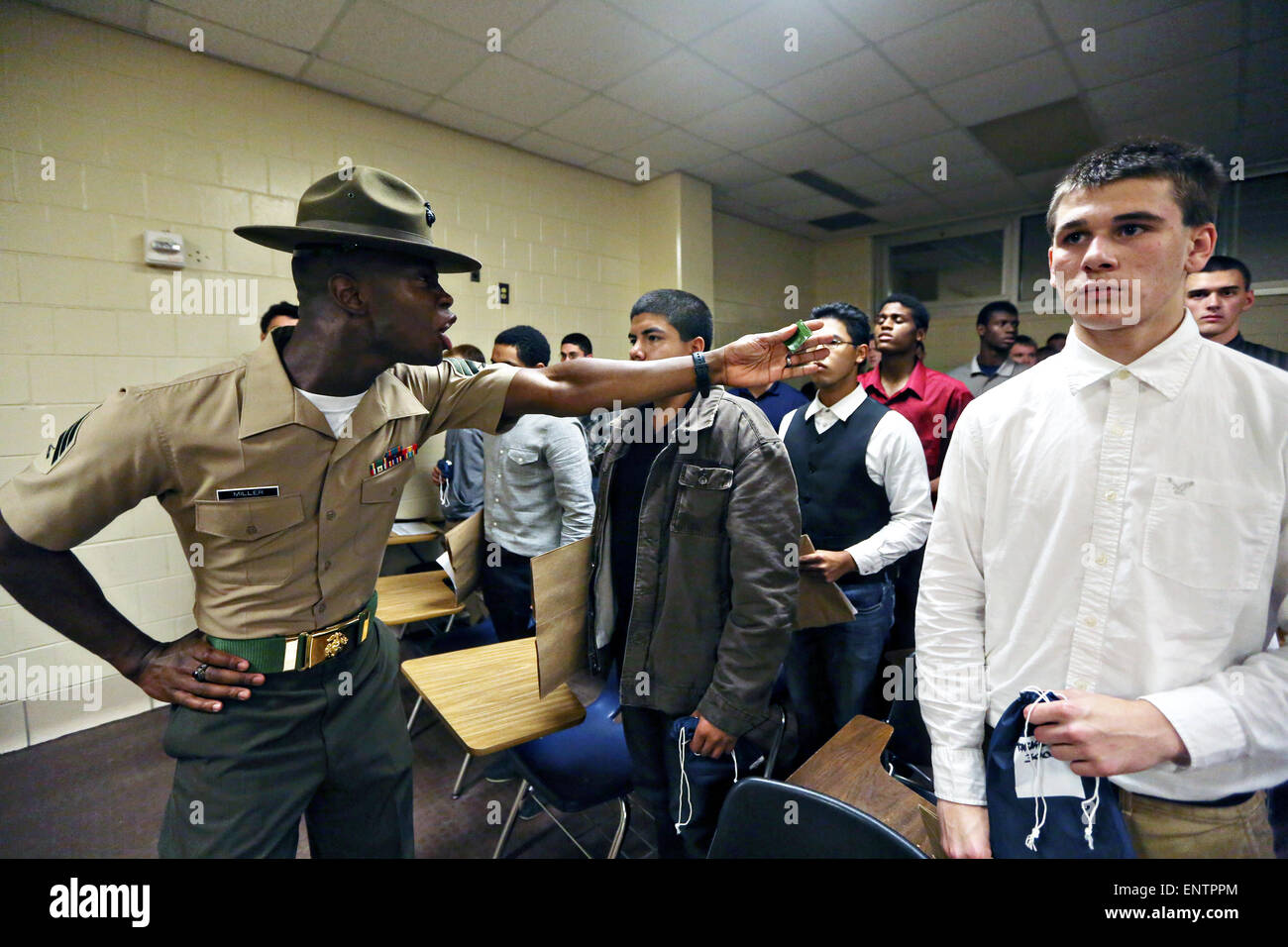 A US Marine Corps drill instructor yells at new recruits during ...