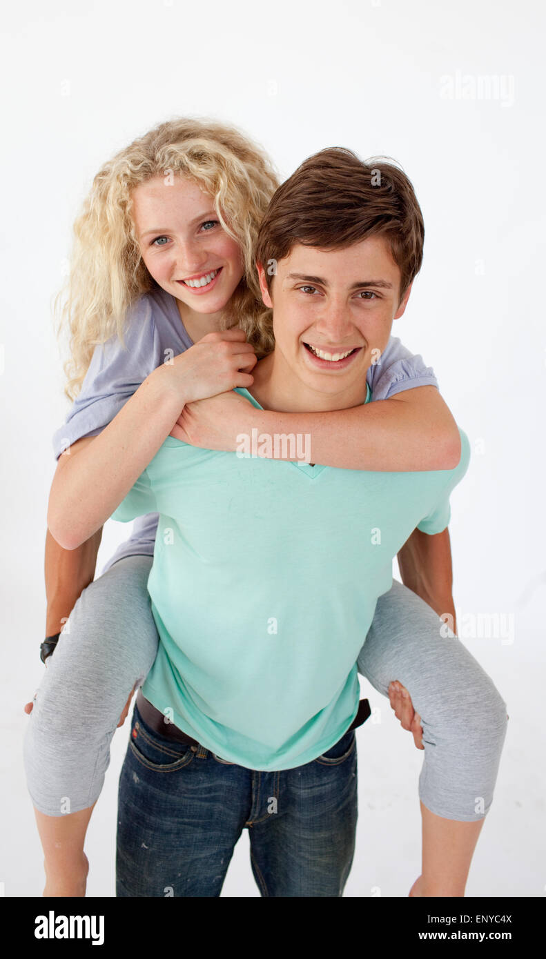 Teen guy giving a friend piggyback ride Stock Photo, Royalty Free ...