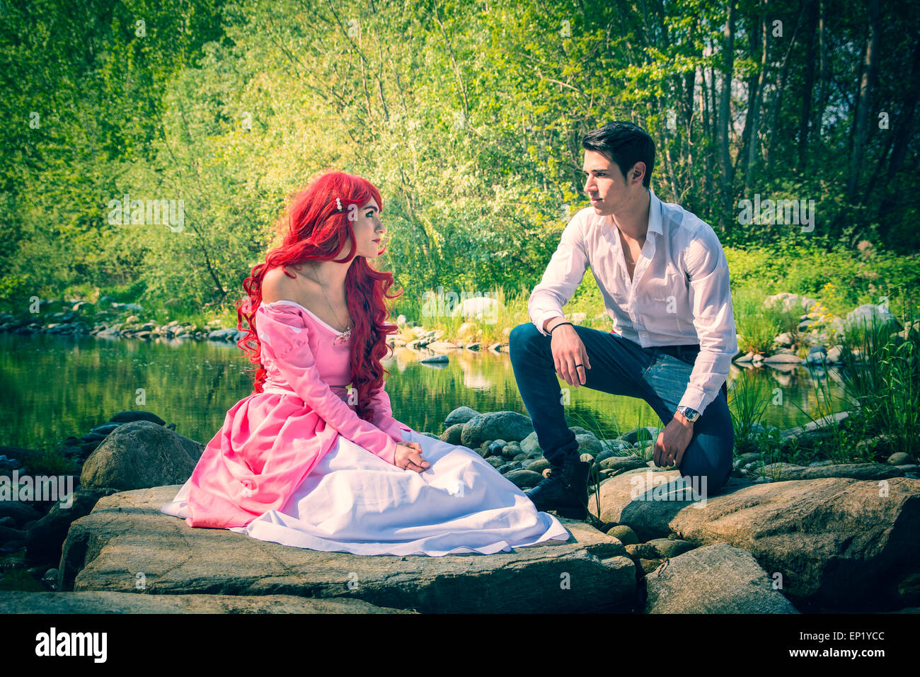 Romantic Fairy Tale Couple Sitting on Rocks at River Side ...