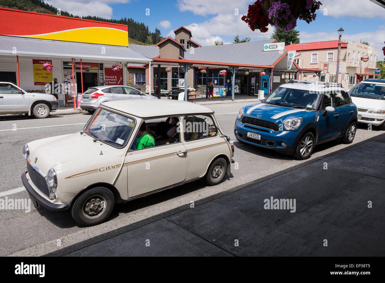 Old and new model Mini cars parked in Reefton, New Zealand Stock ...
