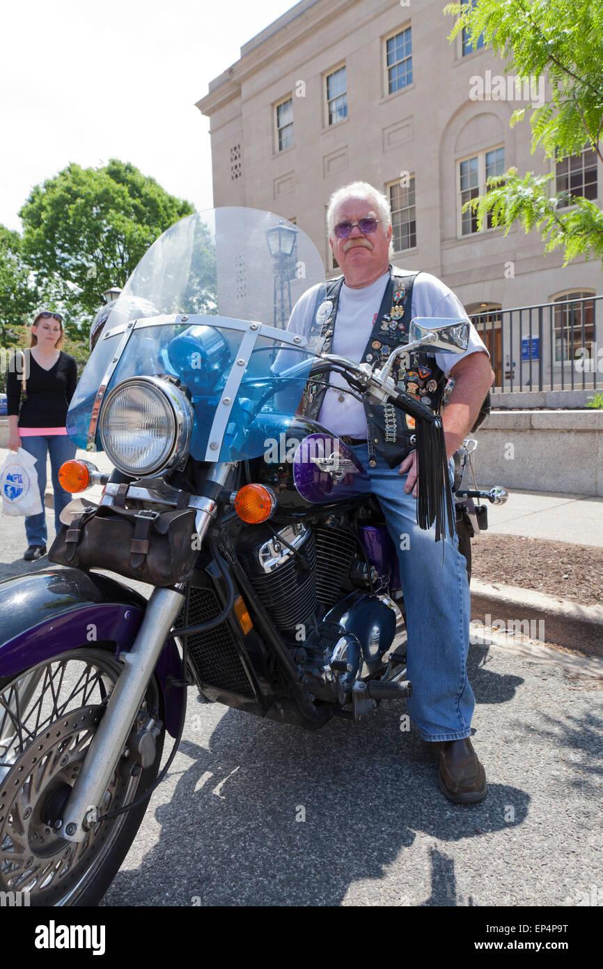 Elderly Man Sitting On Honda Shadow Motorcycle