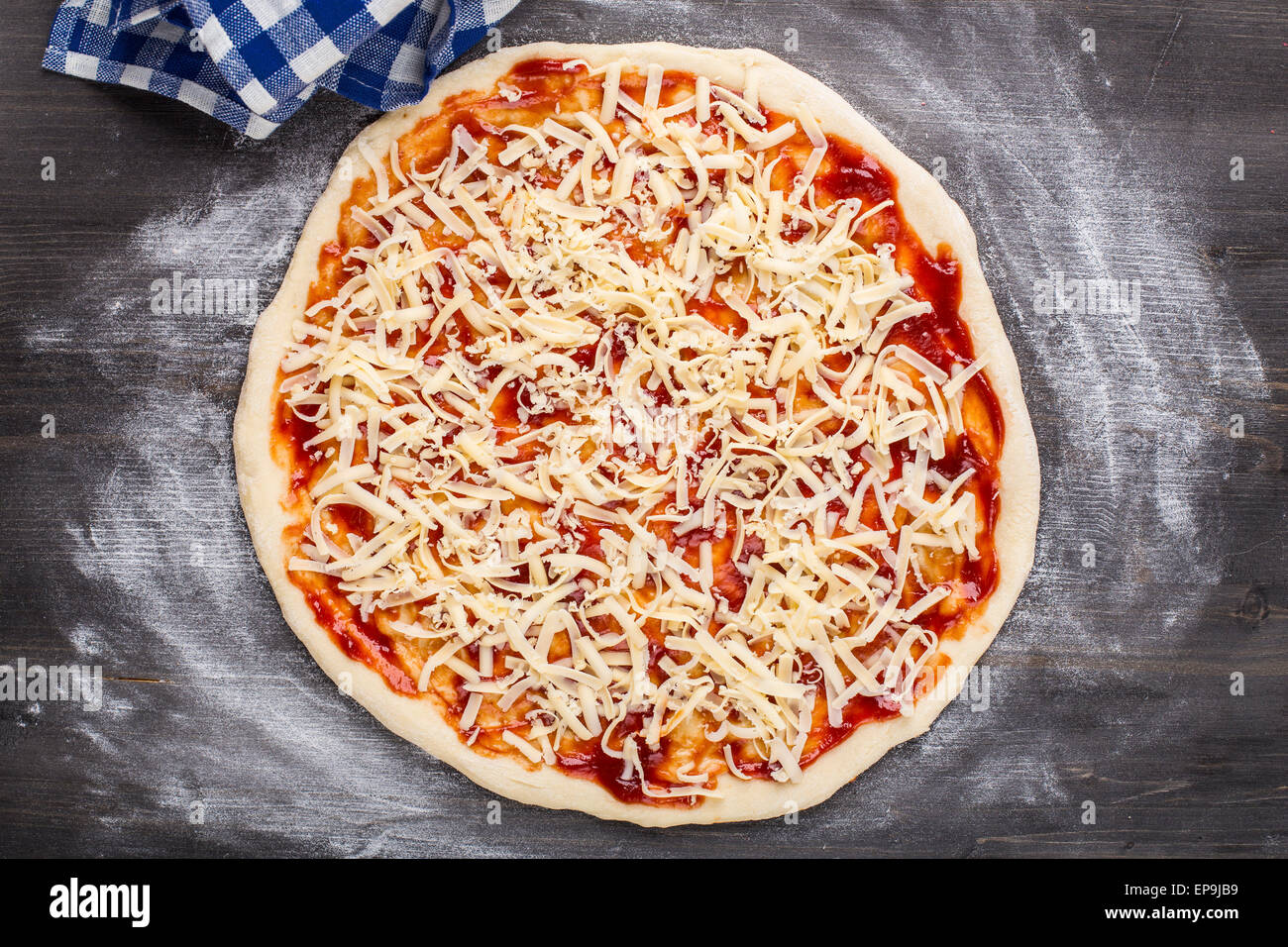 Making Of Pizza Tomato Sauce And Cheese On A Dough Stock Photo Royalty Free