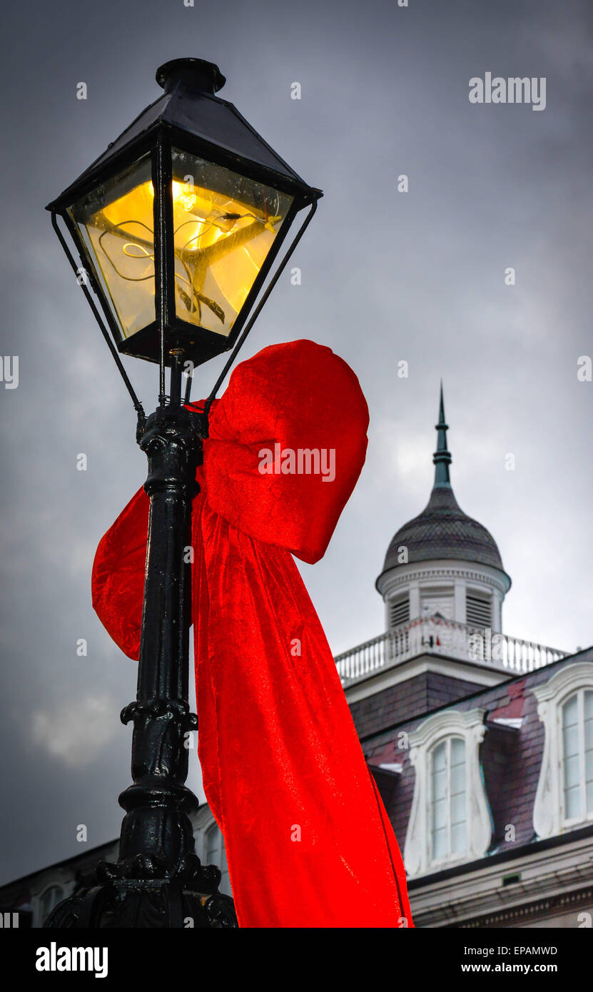 Big red bows hang from the lamp posts near louisiana state museum big red bows hang from the lamp posts near louisiana state museum jackson square in french quarter in new orleans la aloadofball Gallery