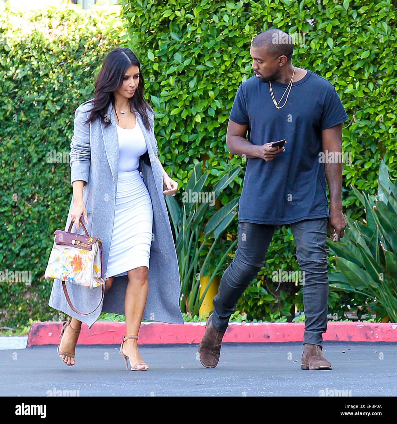 hermes wallet price - Kanye West And Kim Kardashian, Who's Holding An Original Hermes ...