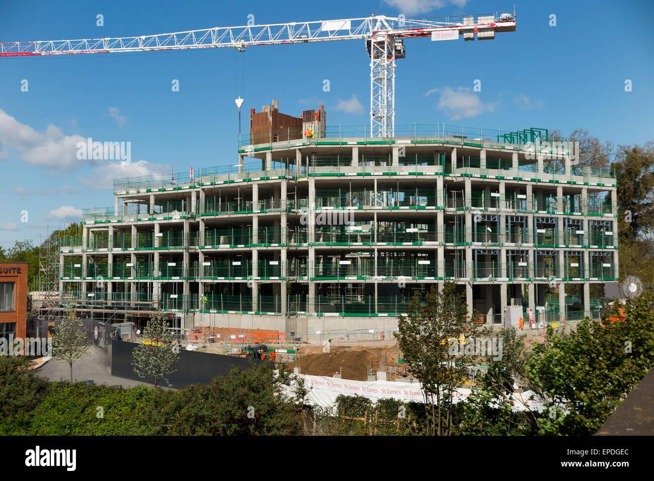 construction site exterior partly built housing block new construction site exterior partly built housing block new build building apartment block apartments flat flats uk