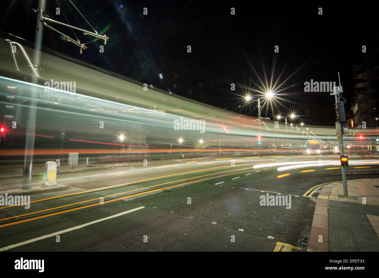 Light Trails Left By A Bus Turning A Corner On Princes Street In Stock Photo