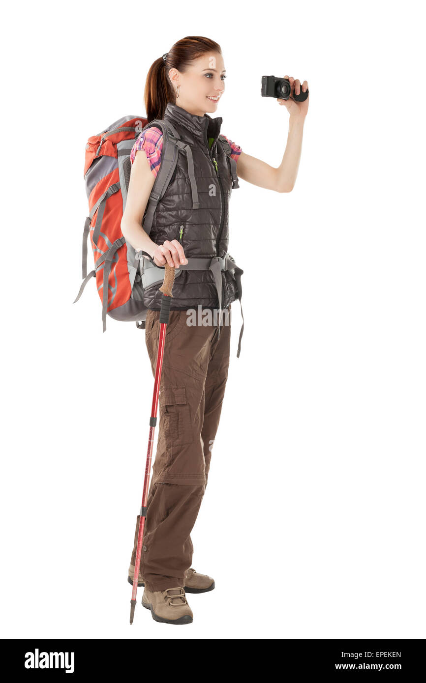 Young Female Hiker Holding Camera Isolated On White Background Standing In Full Length Wearing Outdoor Hiking Outfit