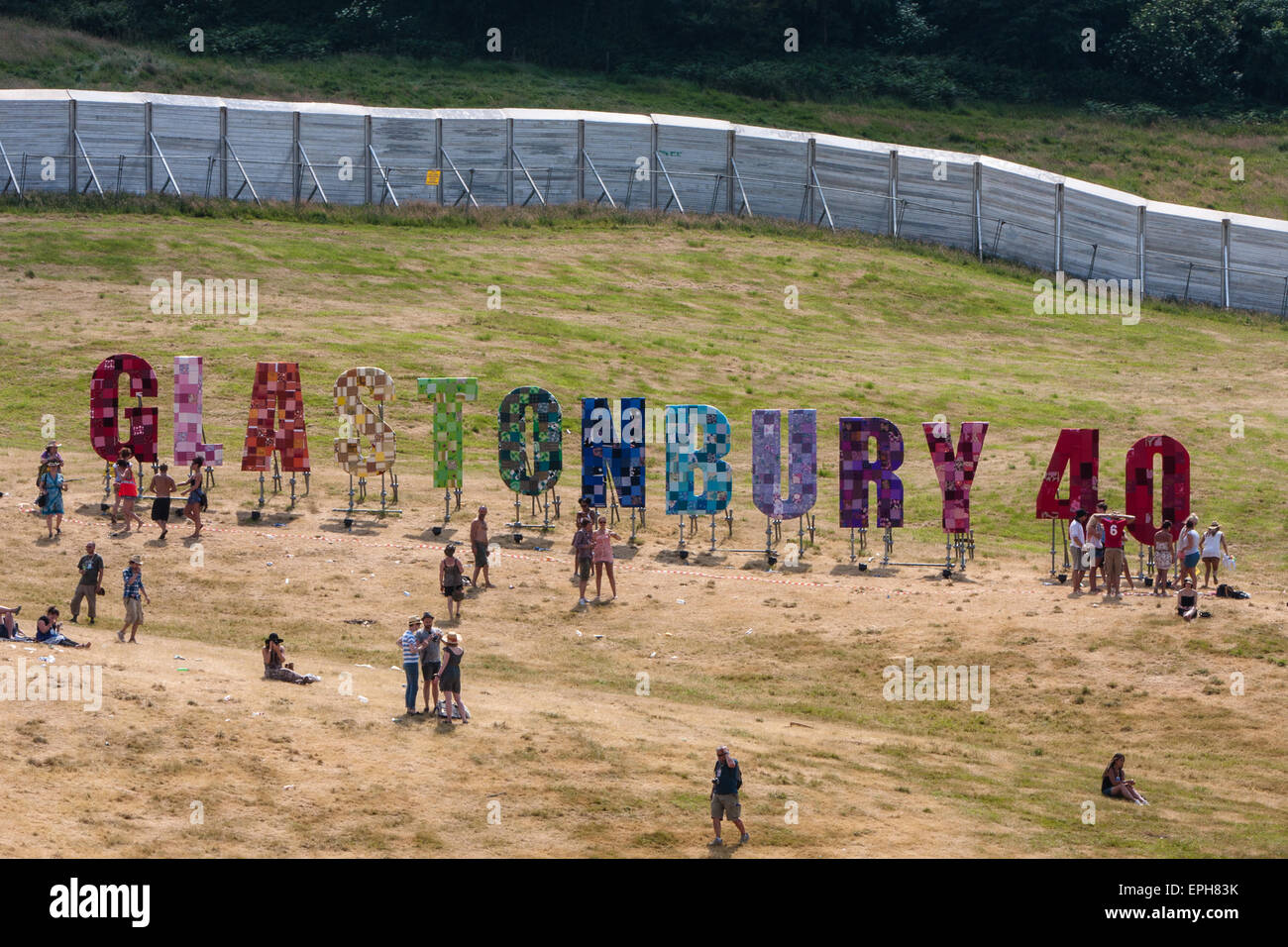 Ring of steel fence and 40th anniversary sign 1970 2010 at glastonbury festival