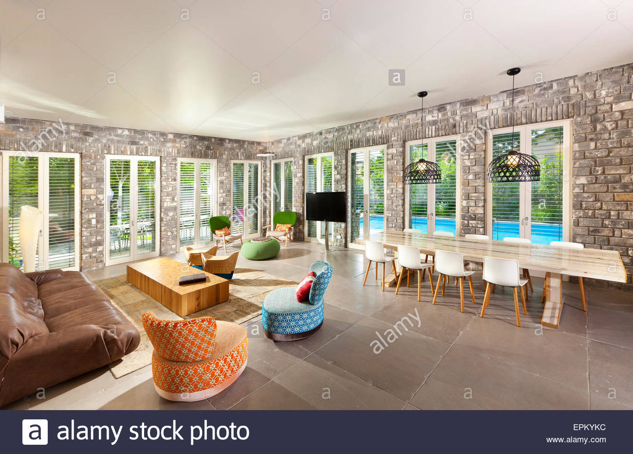 Large Living Room With Sofa And Dining Table Glass Doors Leading To Outside Pool In Villa By Gadi Fiedman Israel