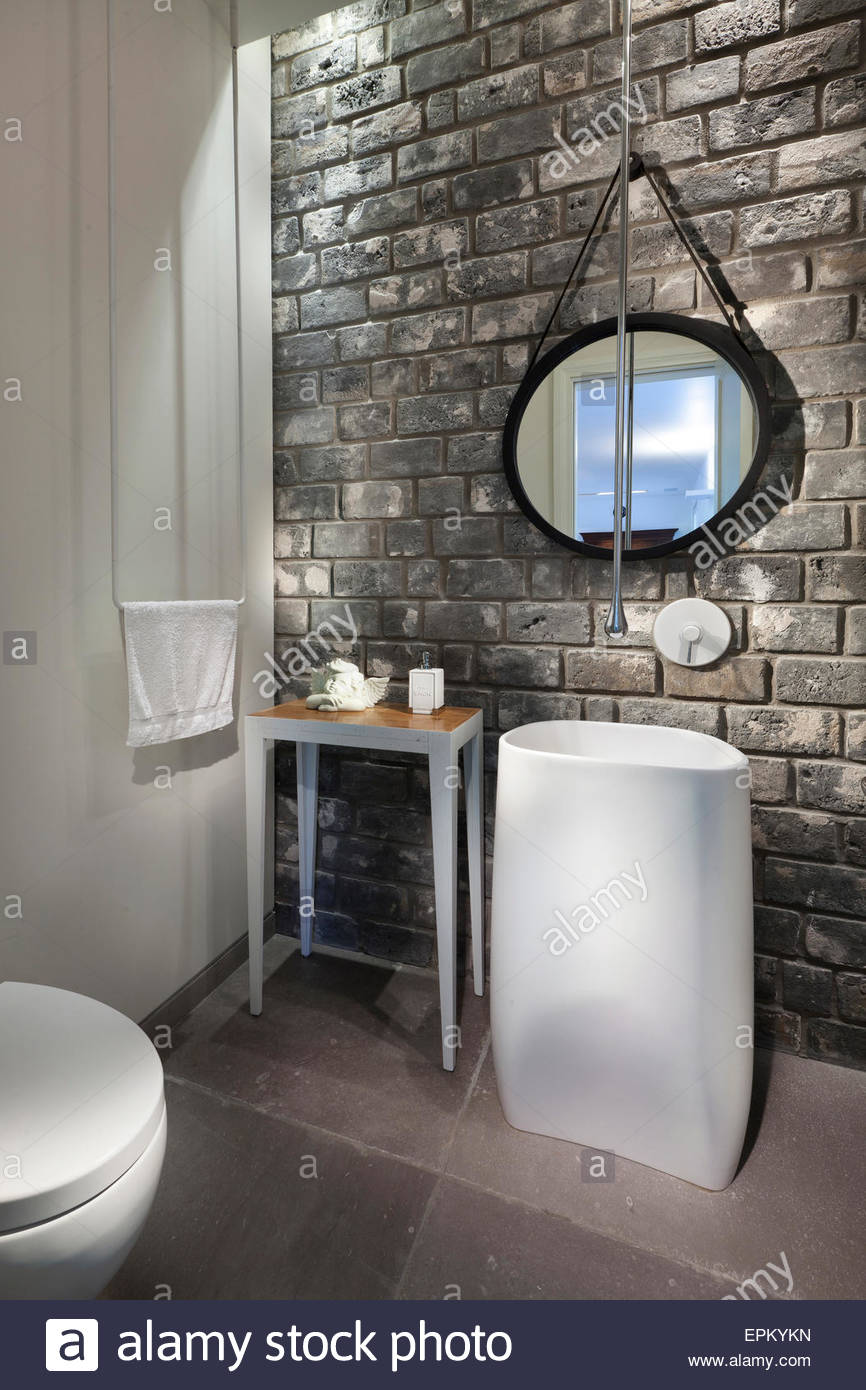 bathroom with grey brick wall in villa by gadi fiedman israel stock photo royalty free image. Black Bedroom Furniture Sets. Home Design Ideas