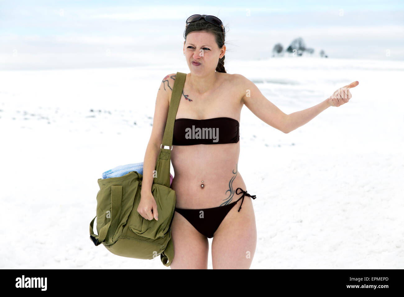bikini in snow Stock Photo - Woman in bikini in snow hitchhiking