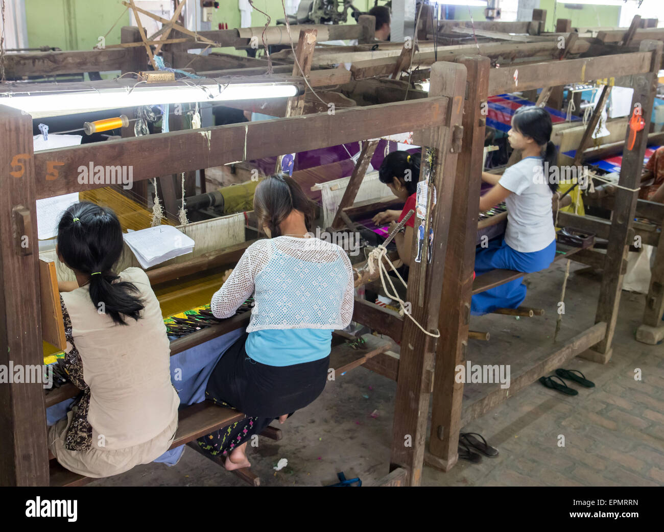 Weaving Workshop With Women Working On Looms Stock Photo