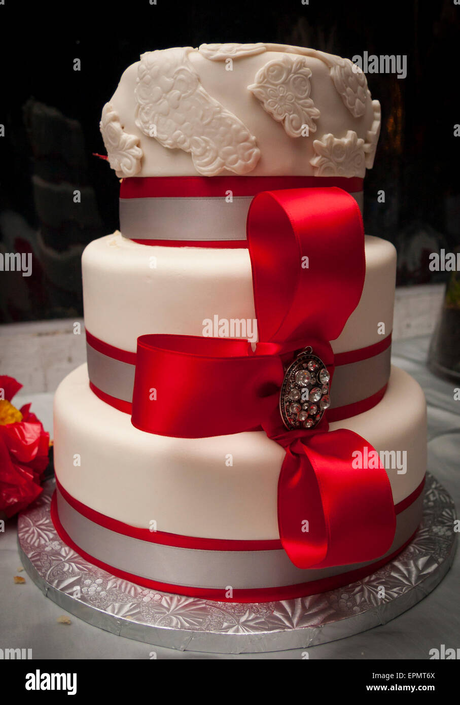 Red and white fondant wedding cake with a big red bow stock photo red and white fondant wedding cake with a big red bow junglespirit Gallery
