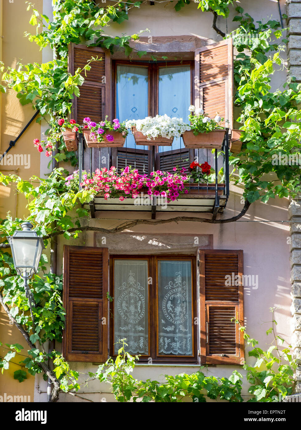 Traditional houses with balconies and flowers bosa for Traditional balconies
