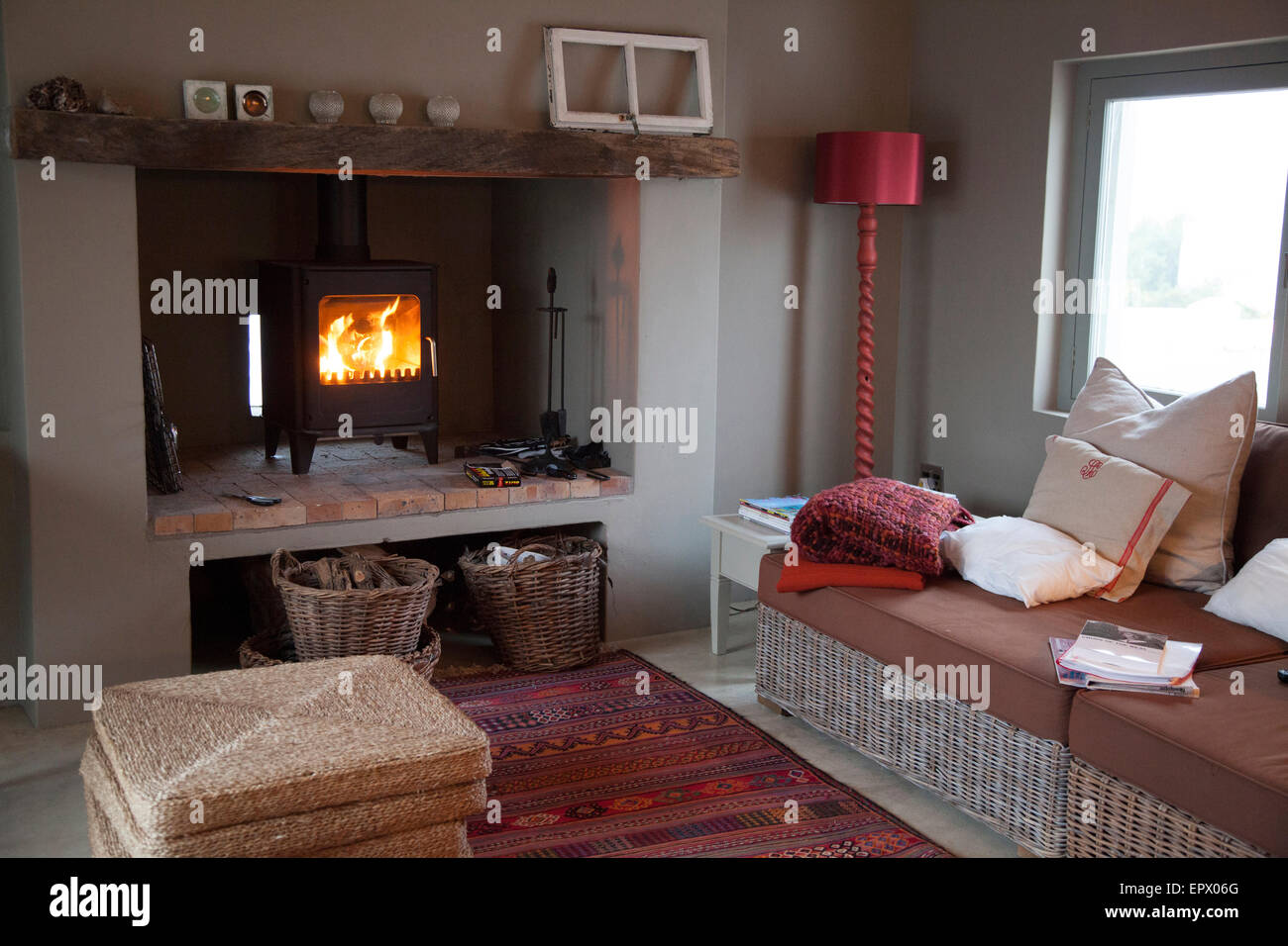 Living room with with wood burning stove and cane furniture in ...