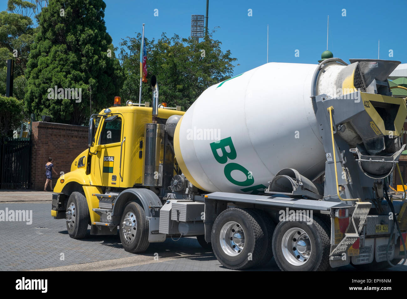 Associated Cement Companies : Boral company ready mix concrete lorry drives by fox stock