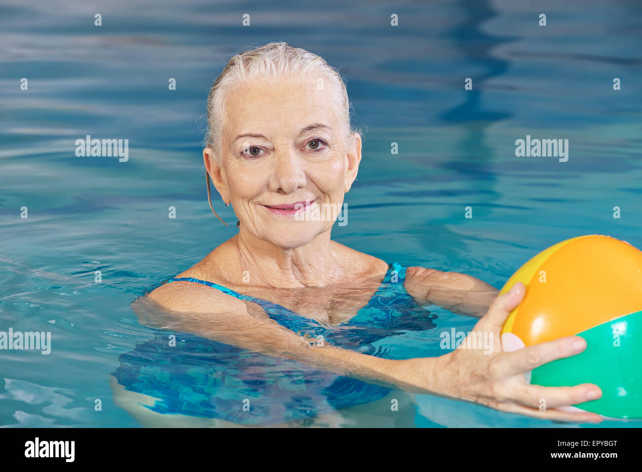 Happy Senior Woman With Water Ball In Swimming Pool Doing Aqua Stock Photo Royalty Free Image