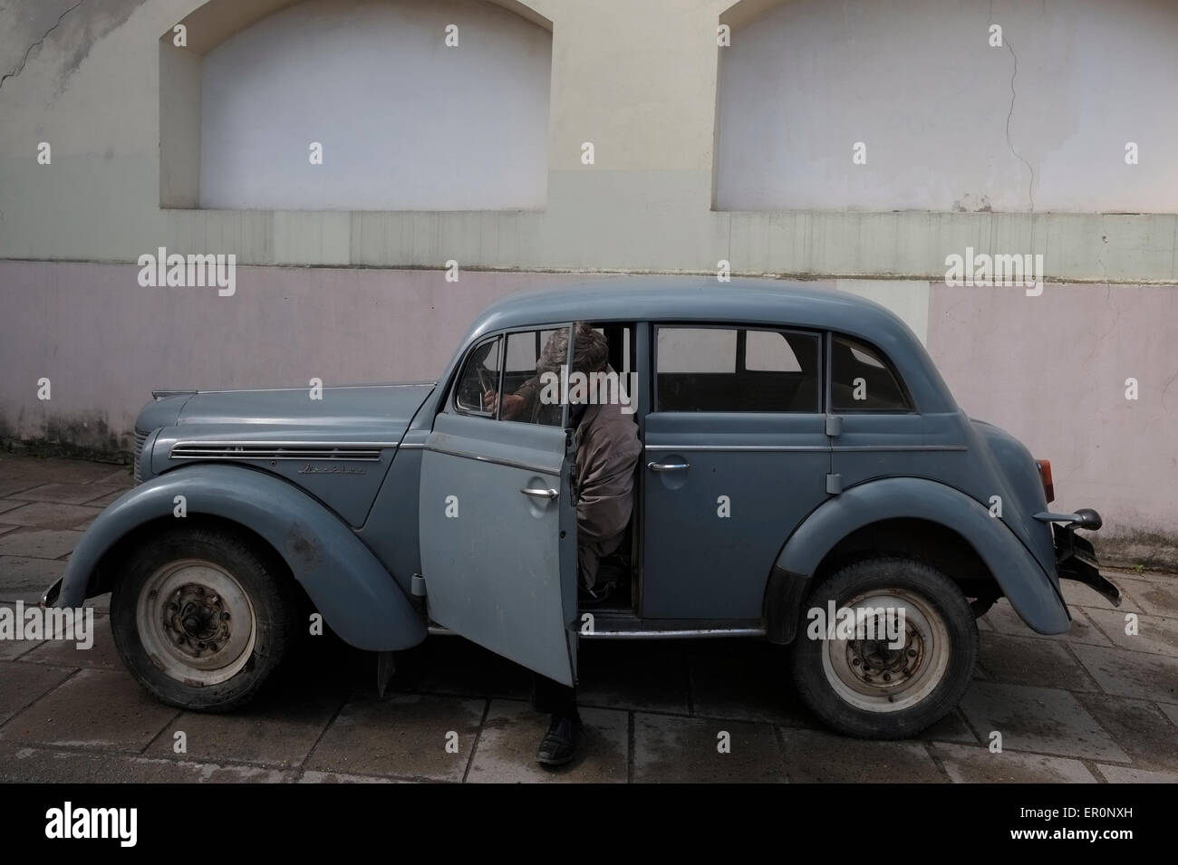 An old car in a movie set in the old town of Vilnius a UNESCO ...