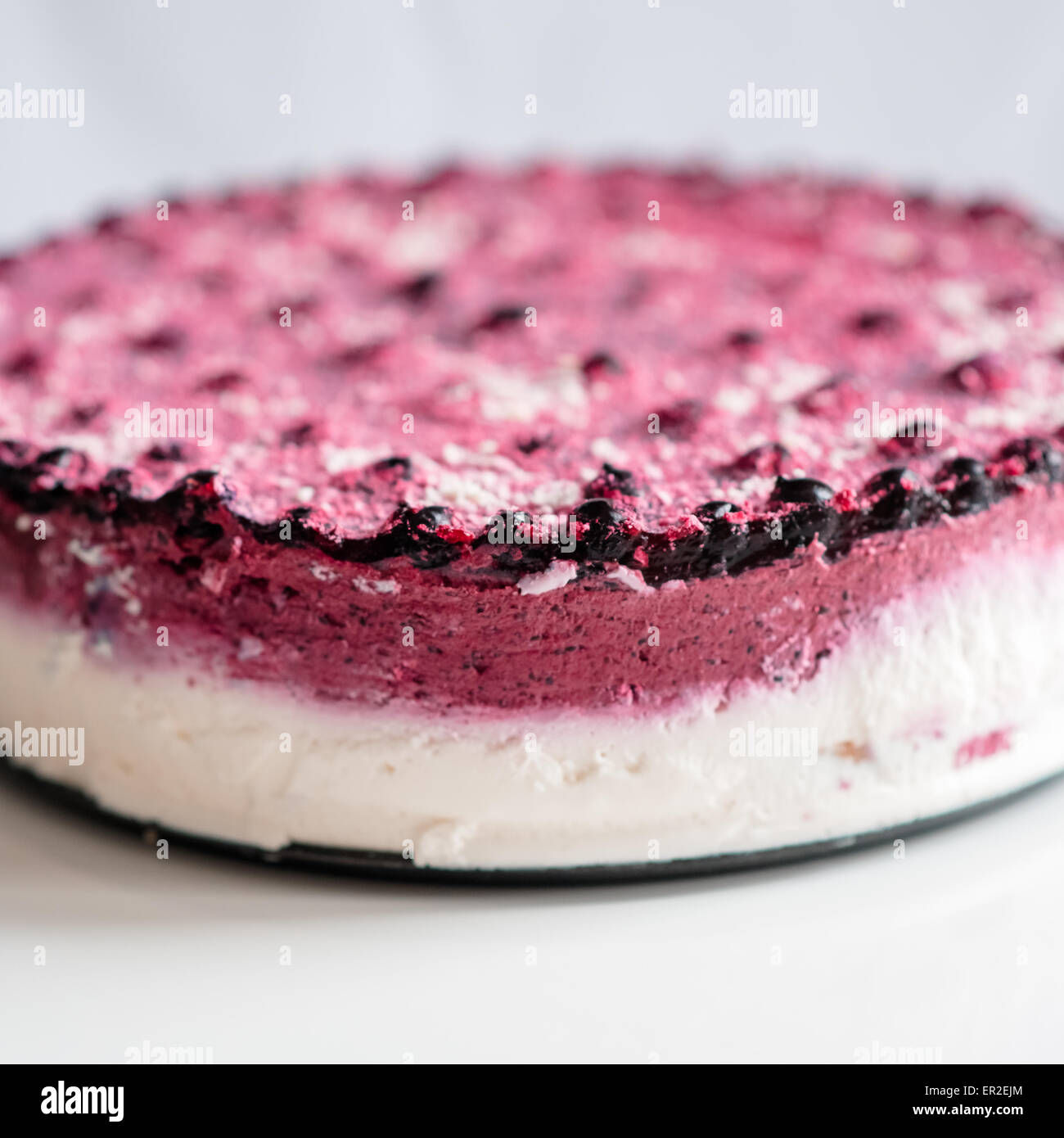 Home made cake with fresh black currant, white chocolate and ...