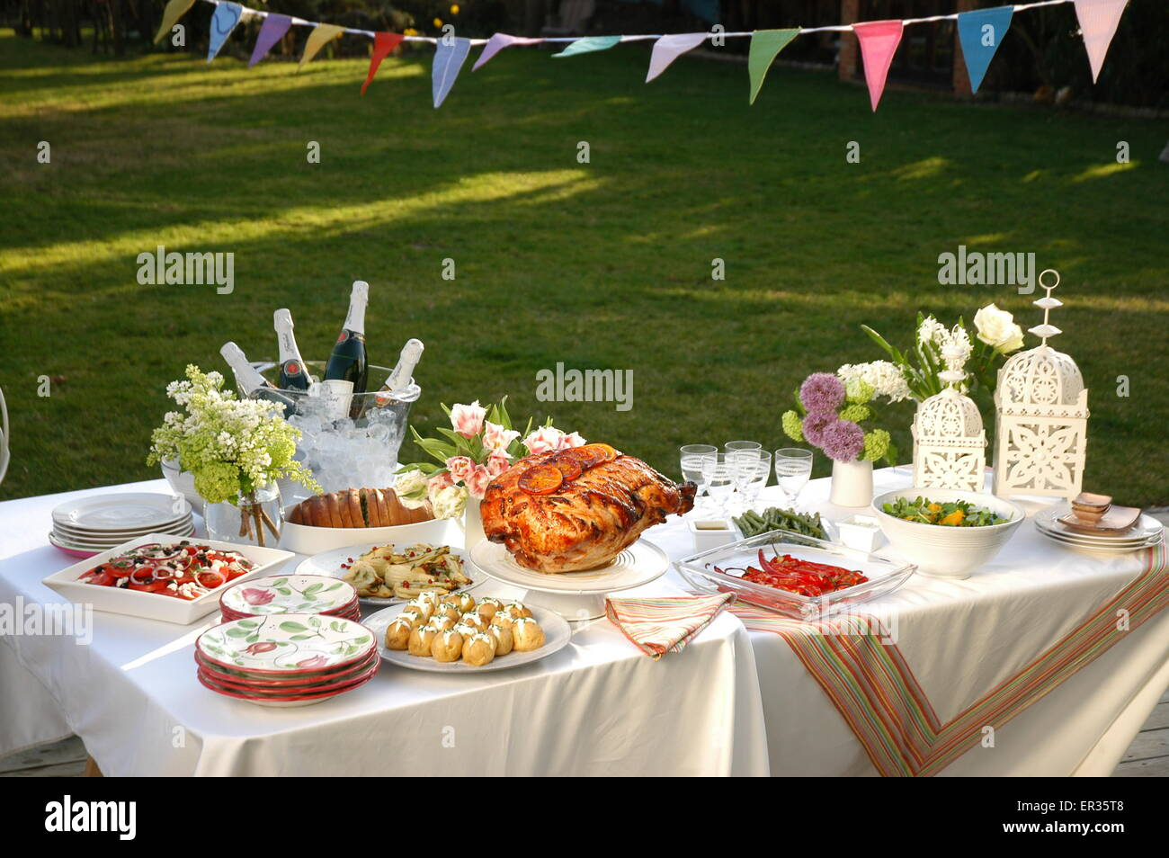 Alfresco dining table with champagne delicious dishes and