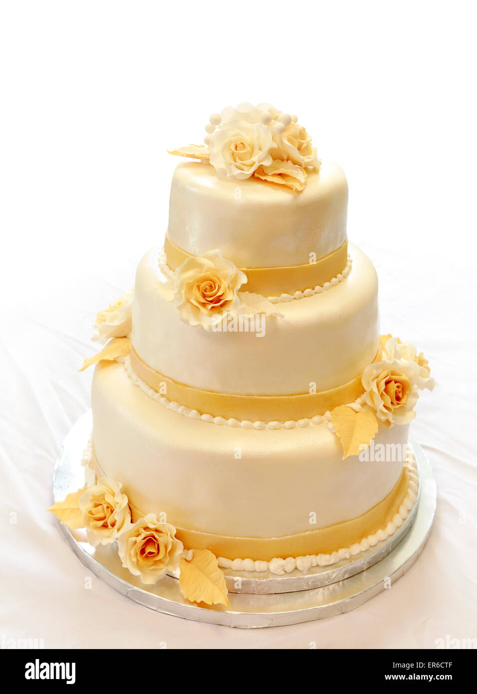 Wedding Cake 3 Tiers Covered In Ivory Fondant Sprayed With Pearl Spray And Yellow Gold Sugar Roses