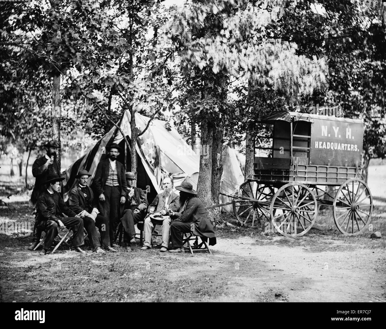 Group at tent and wagon of the New York Herald. Photograph from the main eastern theater of war Meade in Virginia August-November 1863. Date 1863 August. & Bealeton Va. Group at tent and wagon of the New York Herald Stock ...