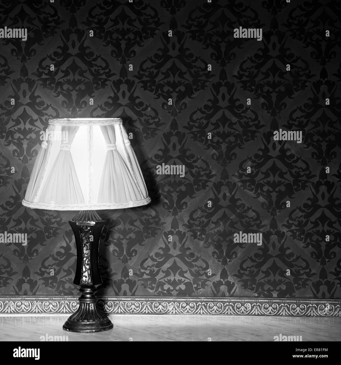 vintage lamp on a retro fireplace toned image red vintage