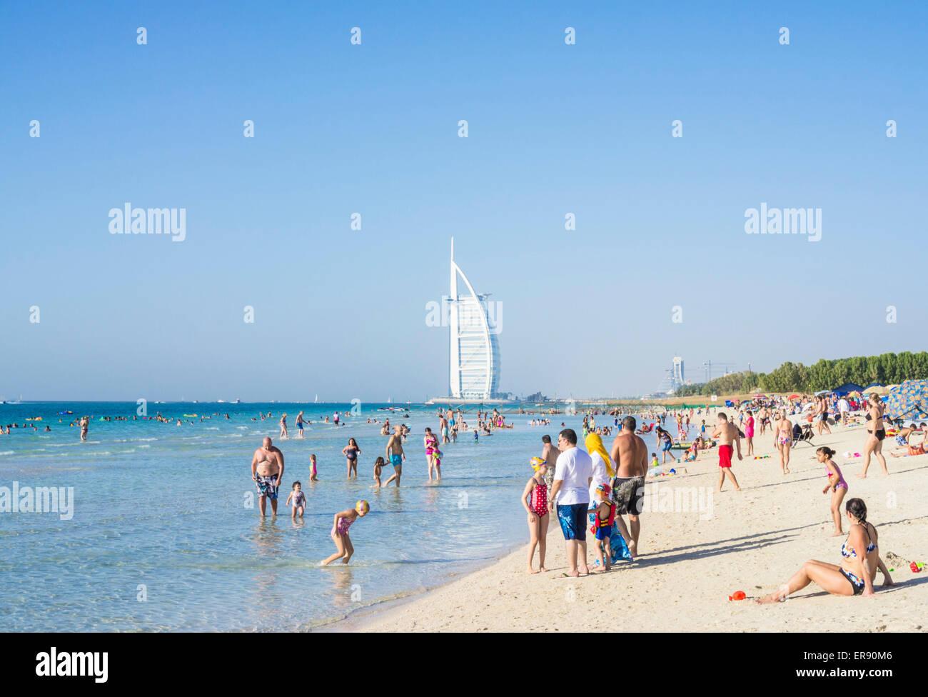 holidaymakers on the public dubai beach near the burj al arab