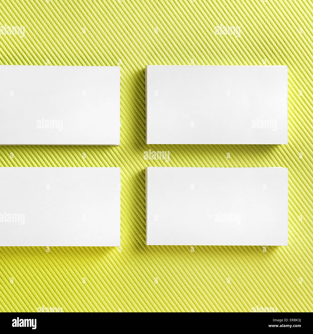 Photo of blank business cards on green background. Template for ID ...