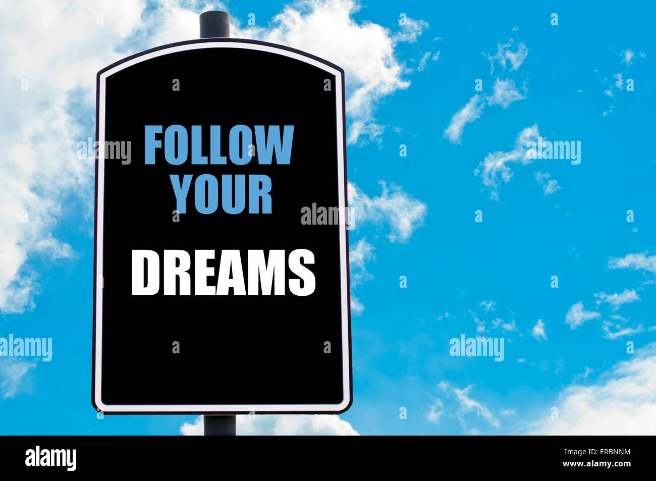 FOLLOW YOUR DREAMS Motivational Quote Written On Road Sign Isolated Over  Clear Blue Sky Background With Available Copy Space