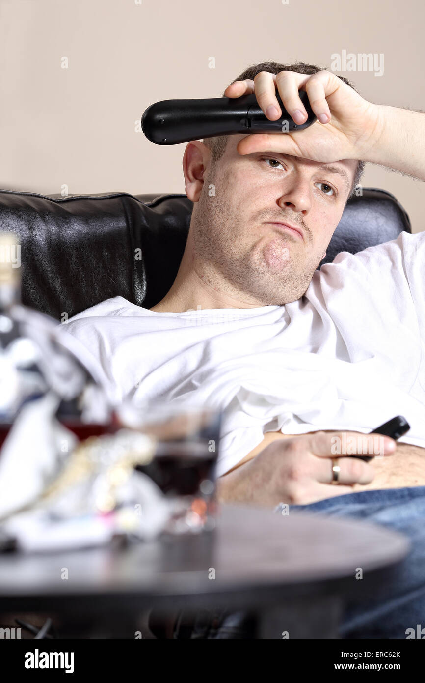 Lazy guy on the couch watching TV Stock Photo, Royalty Free Image ...