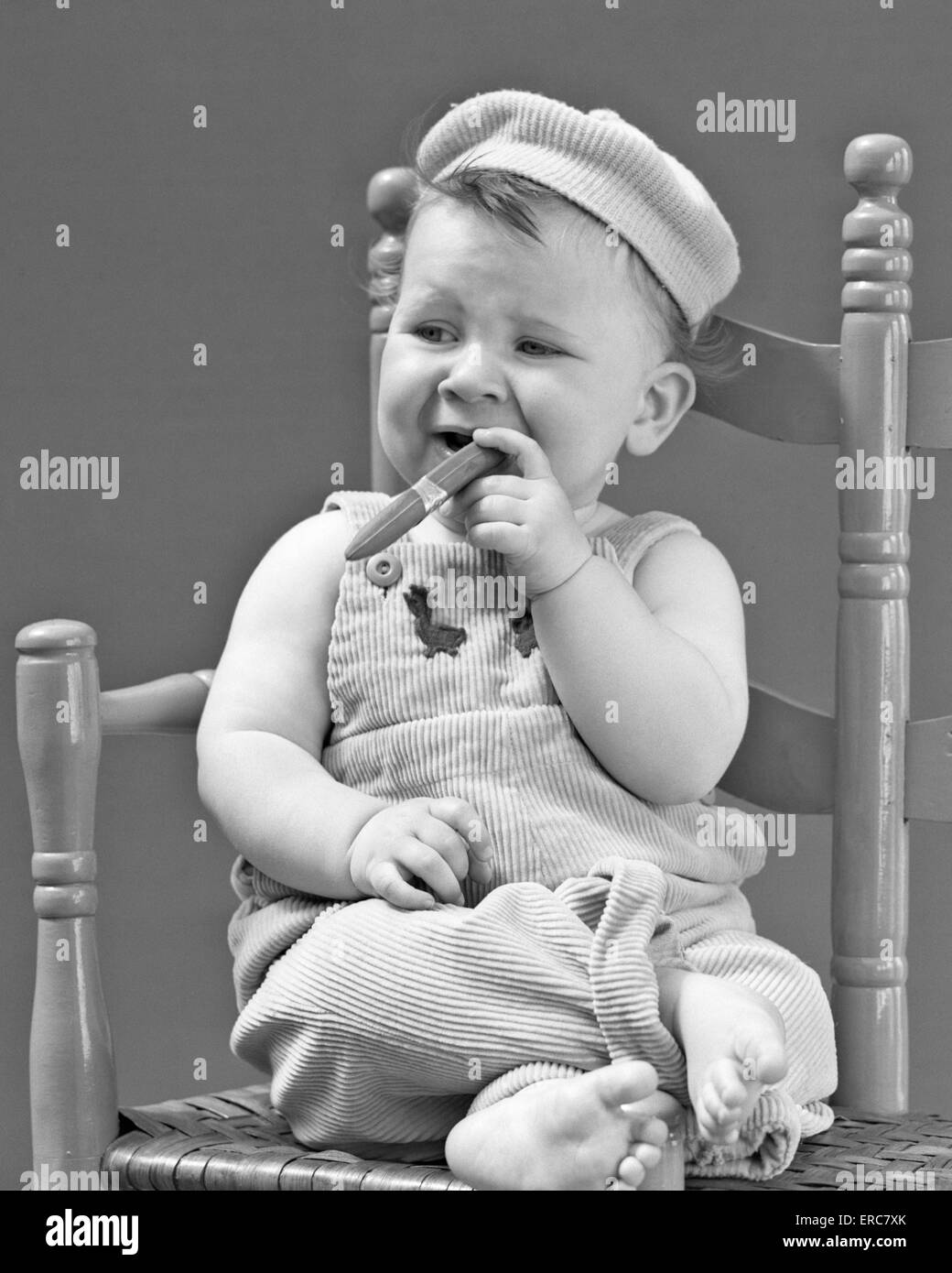 Black child sitting in chair - 1940s 1950s Baby Sitting Chair Holding Cigar Looking Very Gangster