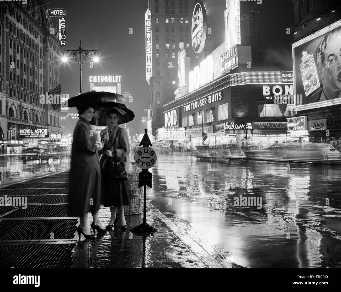 1950s Two Silhouetted Women At Bus Stop Under Umbrellas