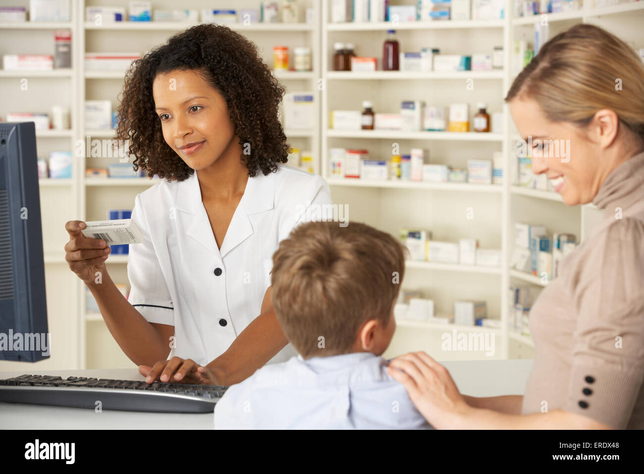 old american pharmacy stock photos old american pharmacy stock pharmacist in pharmacy mother and child stock image