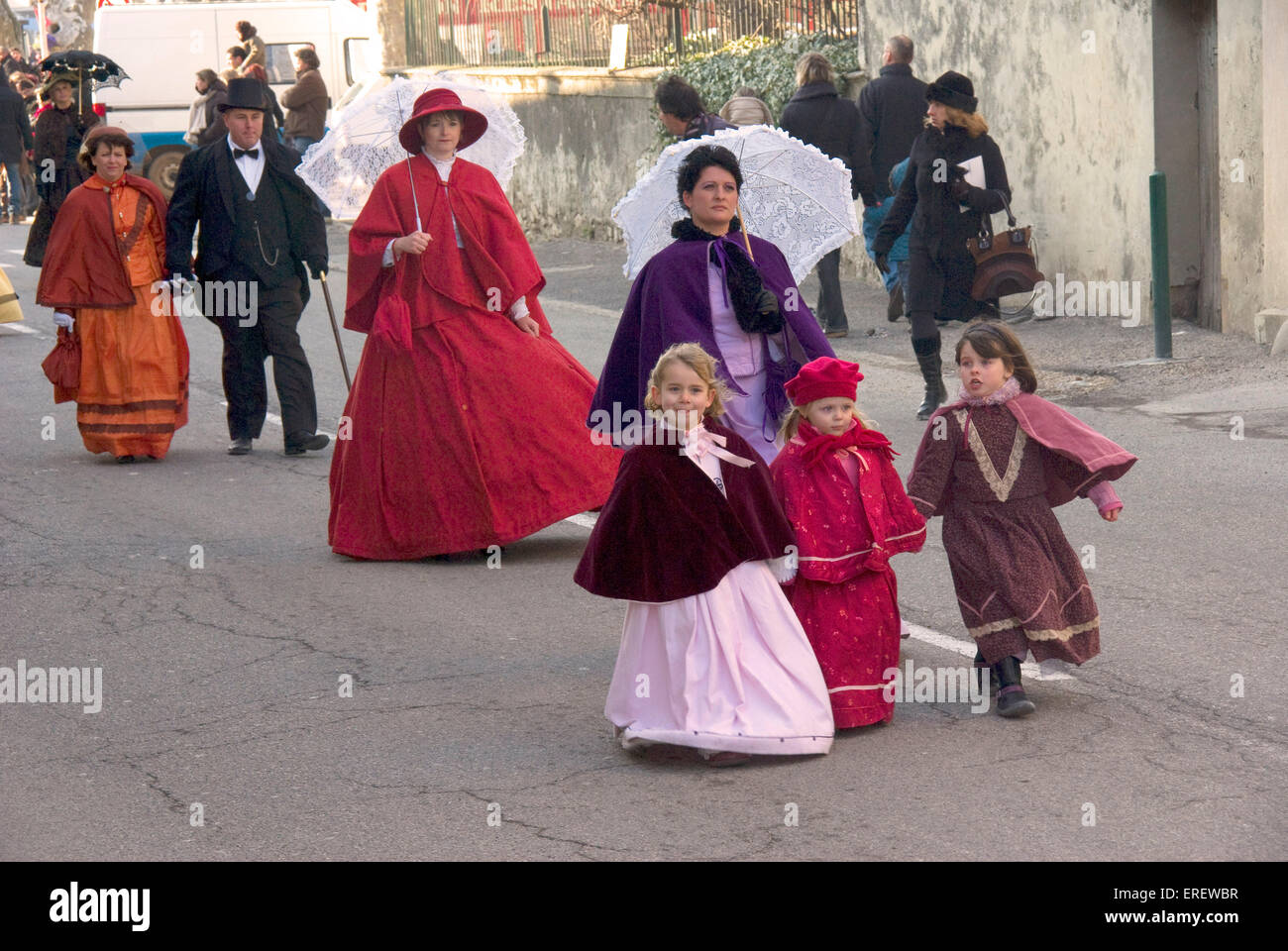 people in victorian costumes taking part in a valentines day parade in the village of roquemaure southern france