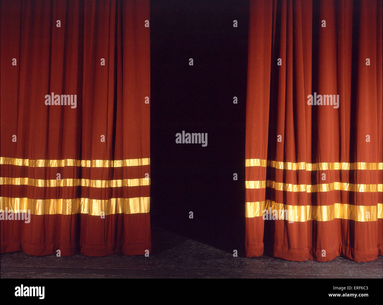 Closed theater curtains -  Stage Curtains Red Velvet With Gold Half Open Stock Photo