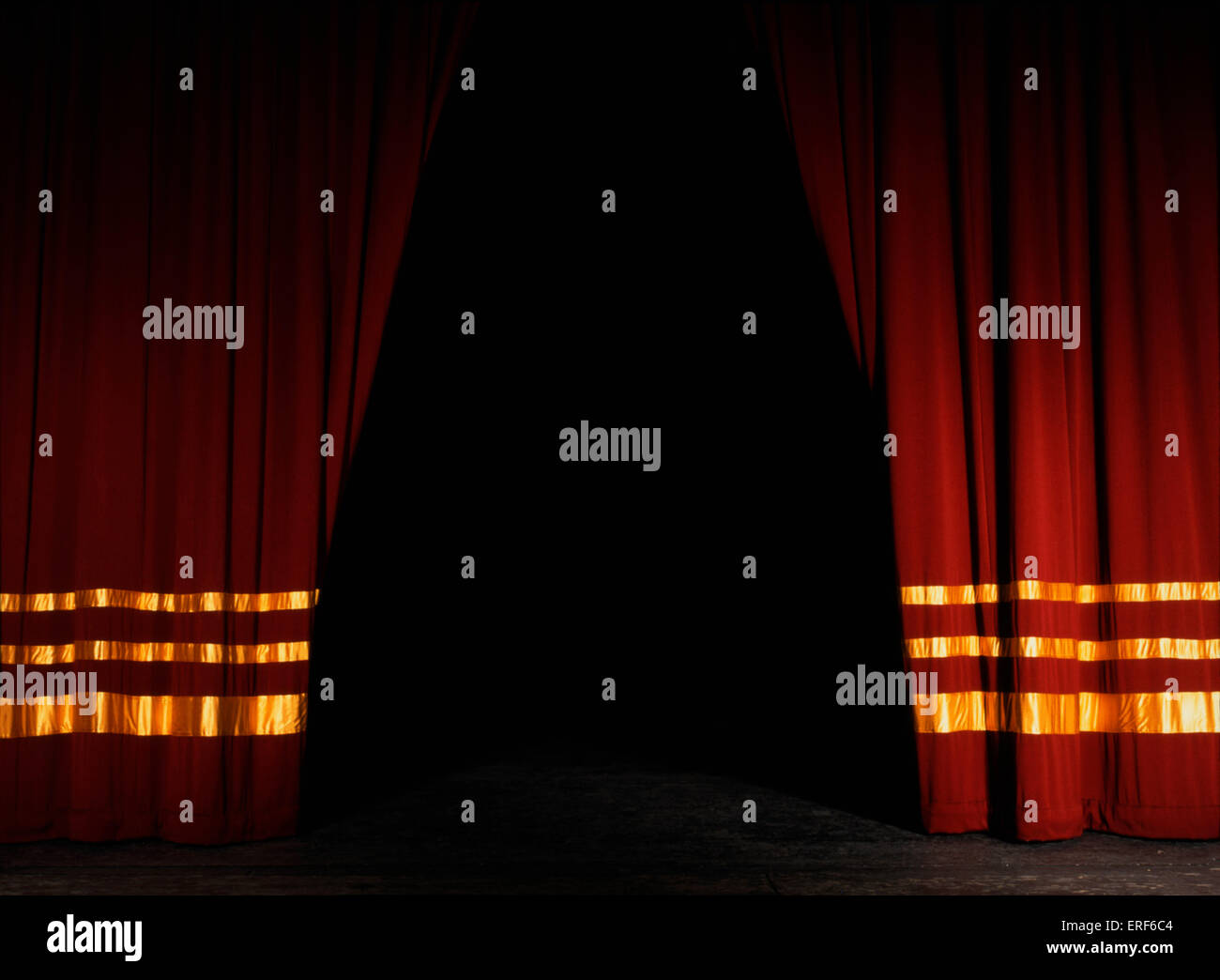 Stage curtains . Red Velvet with gold. Half open. Opening night ...