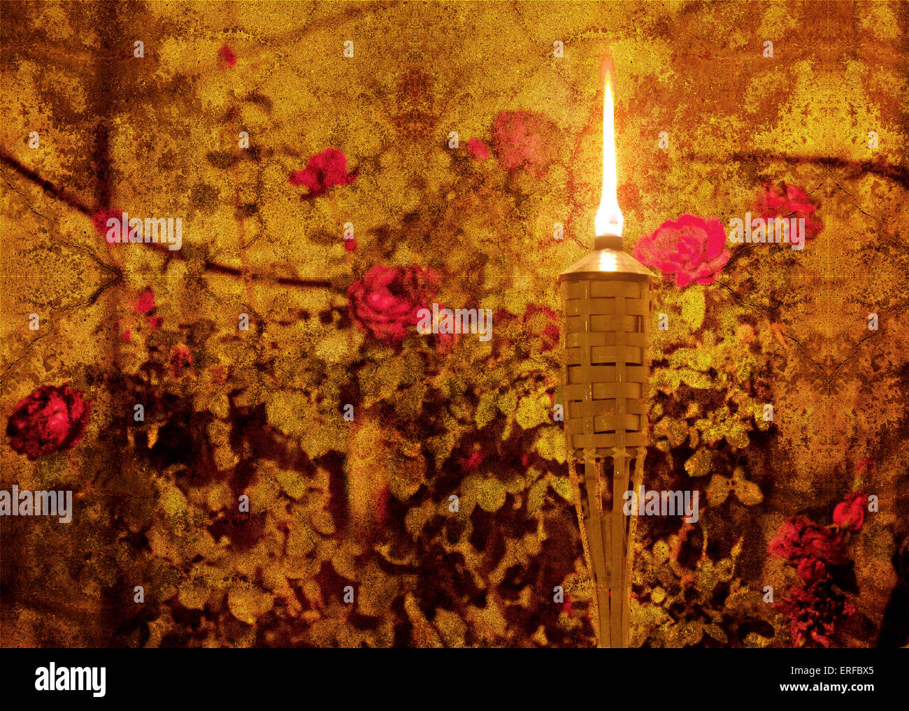 vintage style textured picture of glowing torch in a flower garden stock photo vintage style textured picture of glowing torch in a flower garden texture added grunge effect picture retro style effect add