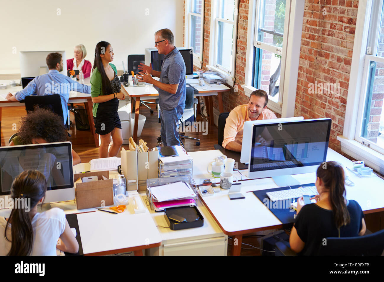 wide angle view busy design office. Wide Angle View Of Busy Design Office With Workers At Desks O
