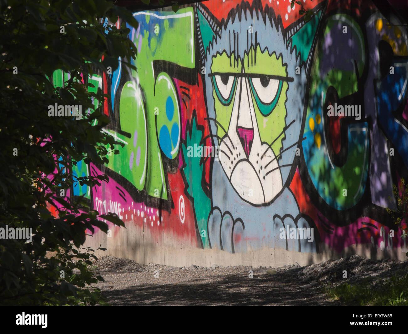 Grafitti art oslo - Street Art Graffiti Miserable Looking Cat With Colourful Letters A Decorative Concrete Wall