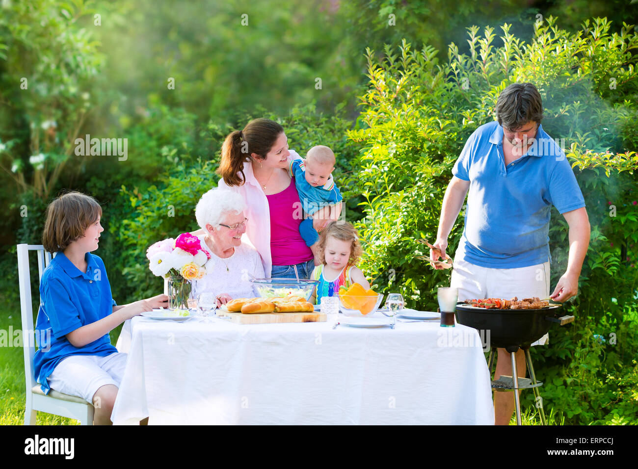 Grill Barbecue Backyard Party Happy Big Family Enjoying BBQ Lunch With Grandmother Eating Meat In The Garden Salad