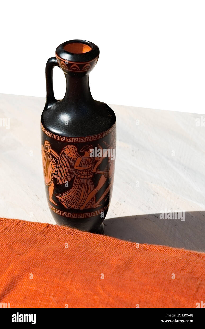Ancient greek lekythos small container for olive oil on a table ancient greek lekythos small container for olive oil on a table isolated against white background vertical photography reviewsmspy