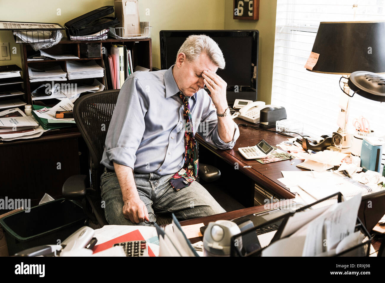 Businessman in Messy Home Office, USA Stock Photo, Royalty ...