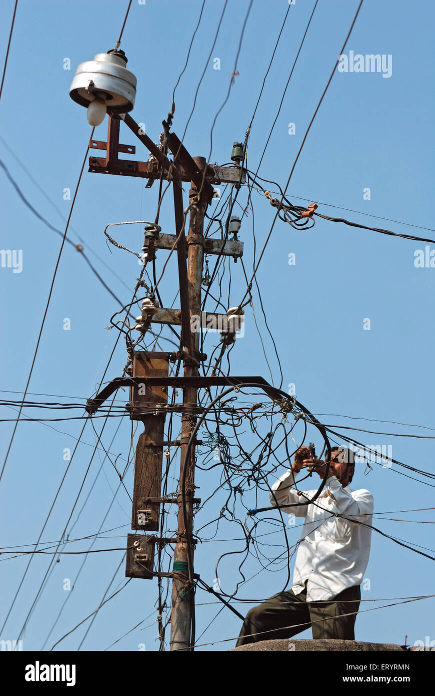 High Tension Cable : Electrician working on high tension electric wire