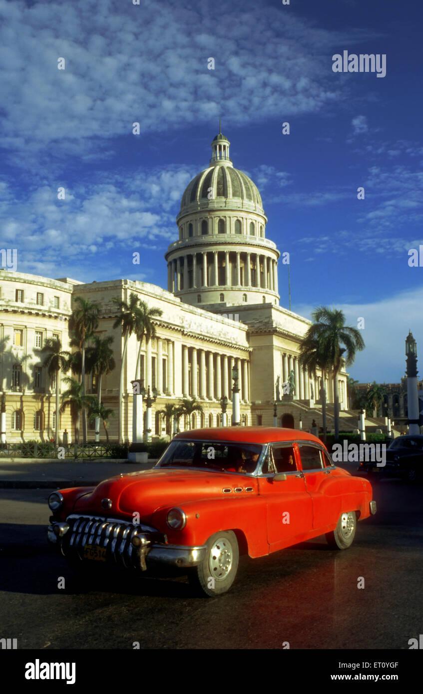 Old car 1950s Chevrolet passing the Capitolio Nacional, Havana, Cuba ...