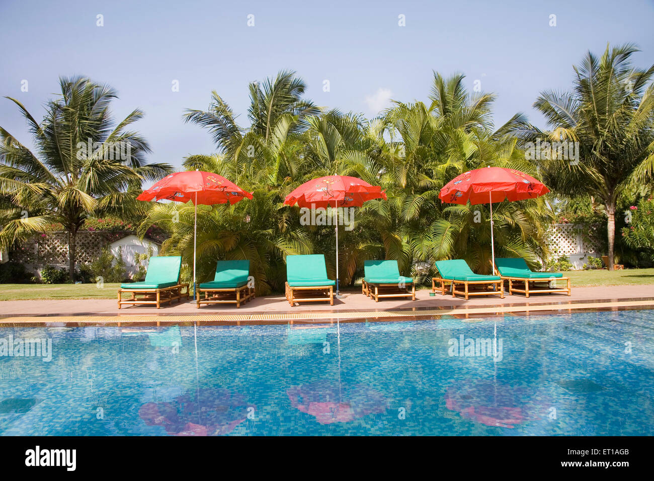Three Red Color Beach Umbrella Near The Swimming Pool Blue Water Stock Photo Royalty Free Image